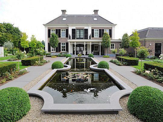 https://walhalla.com/media/vakmannen/373/project-172/Romantische-tuin-in-harmonie-met-het-huis-1192-large.jpg